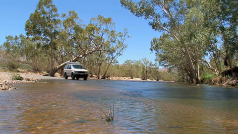 Four wheel drive driving through the water Stock Video Footage