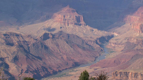Zoom out from a river in the Grand Canyon Stock Video Footage
