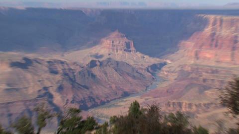 Zoom out from a river in the Grand Canyon Footage