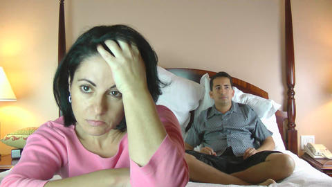 Footage in high definition of angry couple fighting in bed Stock Video Footage