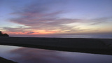 Sunrise bright and colorful through the beach and... Stock Video Footage