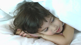 Little girl hiding in the pillow Stock Video Footage