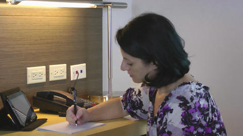 American businesswoman working on tablet and taking notes Stock Video Footage