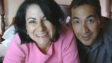 Couple At Home Using Online Technology To Video Chat With Family stock footage
