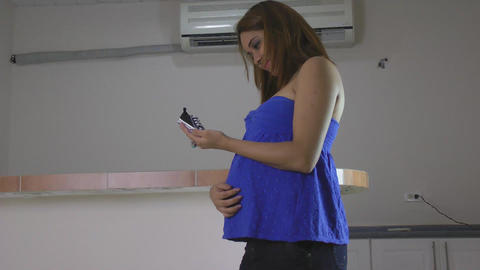 Pregnant woman holding baby booties Stock Video Footage