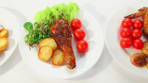 Roasted chicken with potatos salad sprouts and tomatoes Stock Video Footage