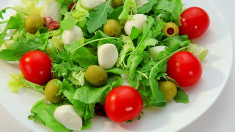 Salad with mozarella cheese, plate with vegetables salad Stock Video Footage