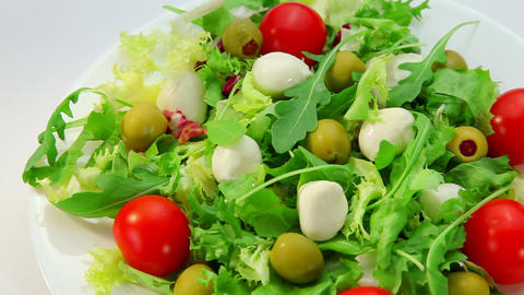 Salad with mozarella cheese, plate with vegetables salad Footage