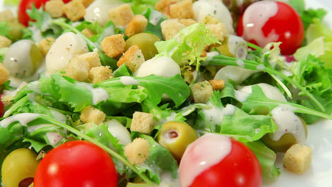 Salad with mozarella cheese - vegetables salad with dressing - close-up Footage