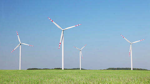 Natural energy - windmills and green grain field Footage