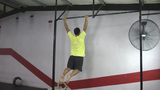 Kipping And Butterfly Pull Ups Crossfit Exercise stock footage
