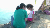 Mother talking with her daughter on the coast Stock Video Footage