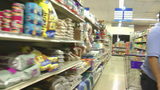 Shopping Cart Moving Through Store stock footage