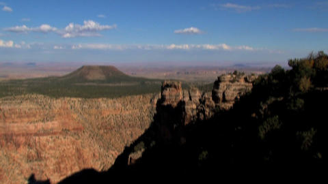 Tilt from the sky to the grand canyon in the shadow Footage