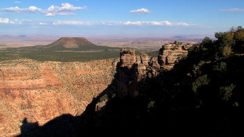 Tilt from the sky to the grand canyon in the shadow Stock Video Footage