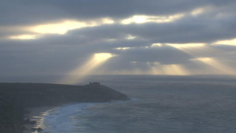 Sunshine through the clouds at the remarkable rock Stock Video Footage