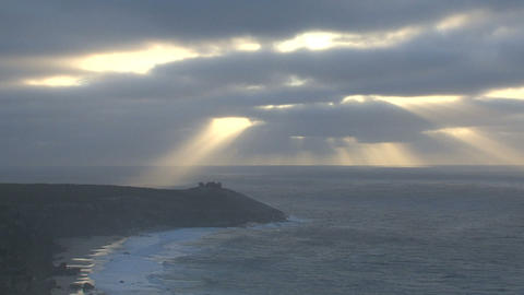 Sunshine through the clouds at the remarkable rock Footage