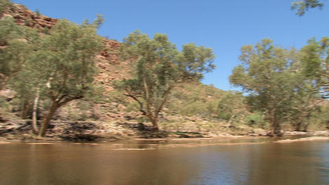 Pan from the a river at the MacDonnell Ranges Stock Video Footage
