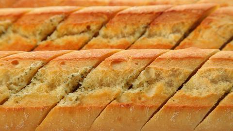 Fresh baked garlic bread Stock Video Footage