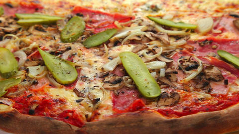 Delicious pizza with ham and vegetables Stock Video Footage