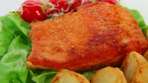 Fried salmon fish fillet with tomatoes, sprouts and potatoes Stock Video Footage