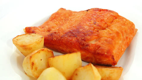 Salmon fried with potatoes Footage