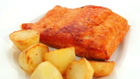 Salmon fried with potatoes Stock Video Footage