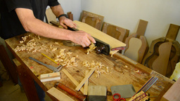 Luthier Giving Wood Planer In Workplace stock footage