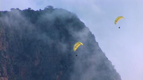 Two paragliders flying Stock Video Footage