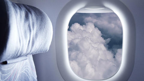 Clouds In The Window Plane stock footage
