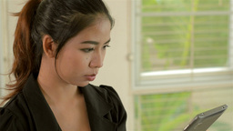 Young Thai Woman Working on Her Tablet PC Stock Video Footage