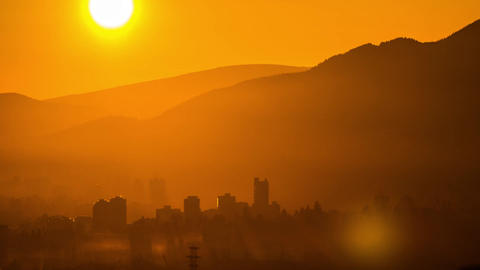 Sunset time with misty fog above buildings Stock Video Footage