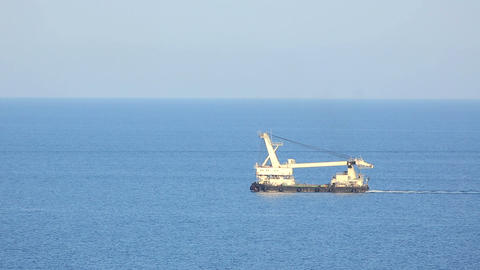 Dredge floating in the the sea (time-Lapse) Footage