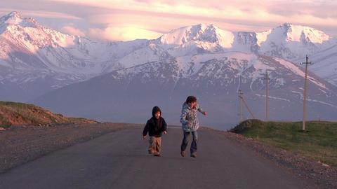 Children run into the setting Sun Stock Video Footage