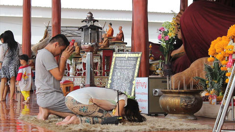 Husband And Wife Paying Respect At Buddhist Temple Footage