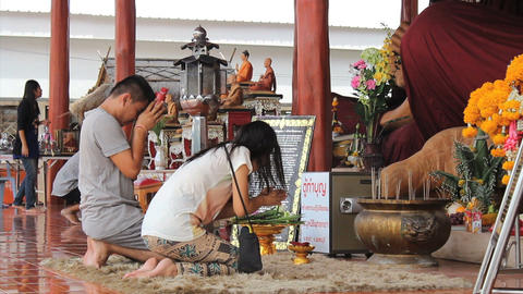 Husband And Wife Paying Respect At Buddhist Temple Stock Video Footage