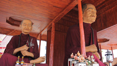 Oversized Monk Statues In Outdoor Buddhist Temple Footage