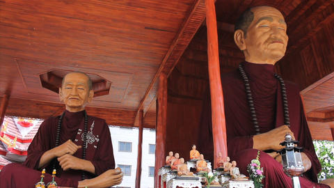 Two Oversized Monk Statues In Buddhist Temple Footage