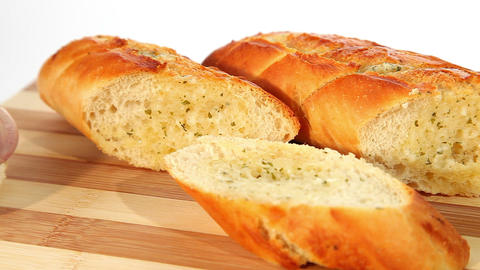 Fresh baked garlic bread with herbs Stock Video Footage