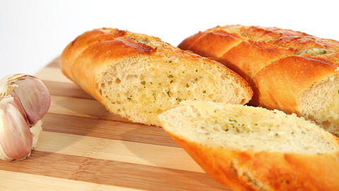 Fresh baked garlic bread with herbs Footage