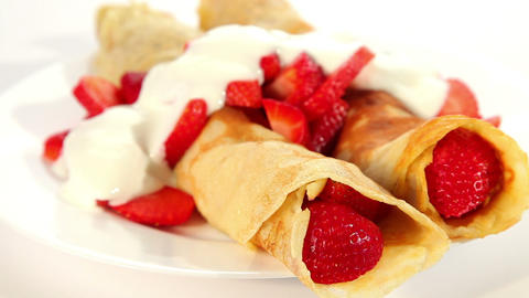 Pancake with strawberry and yogurt, sweet dessert Footage