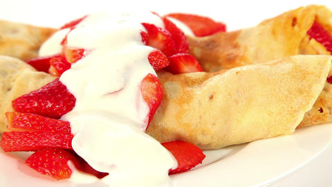 Strawberry crepe pancake with yogurt, sweet dessert Footage