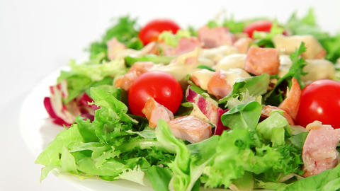 Salad with chciken, lettuce, tomatoes and dressing Stock Video Footage