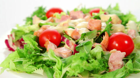 Salad with chciken, lettuce, tomatoes and dressing Footage