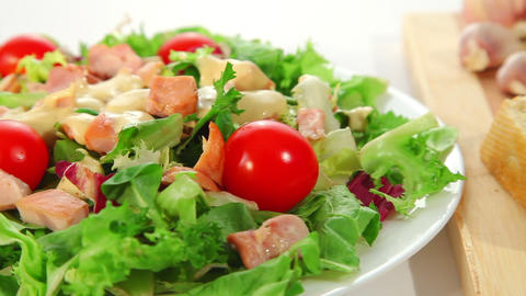Salad with chicken and garlic bread Stock Video Footage