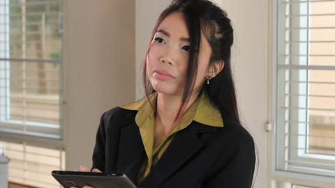 Cute Female Asian Office Worker Using Tablet Stock Video Footage