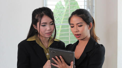 Two Asian Office Workers Using Tablet Stock Video Footage