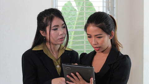 Two Asian Office Workers Using Tablet Footage
