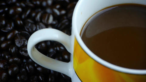 a cup of coffee & coffee beans background,top view Stock Video Footage