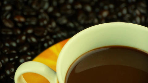 a cup of coffee & coffee beans background,top view Footage